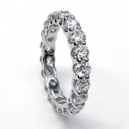 A platinum round diamond U-shape eternity wedding band